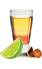The Astro Shot is a relaxing orange shot made from Frangelico hazelnut liqueur, lime juice and grenadine, and served in a chilled shot glass.