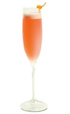 The Bois de Rose is a orange-colored cocktail perfect for New Year's Eve, made from St-Germain elderflower liqueur, Aperol, gin, lemon juice and champagne, and served in a chilled champagne flute.