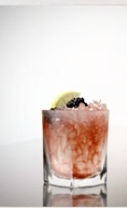 The Bramble Vine is a red colored drink recipe bringing together the aromatic flavors of summer. Made from G'Vine Nouaison, crème de cassis, lemon juice and simple syrup, and served over ice in a rocks glass.