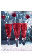 The Candied Cane is a Christmas-season cocktail recipe made from Boca Loca cachaca, blackberry liqueur, lemon juice, simple syrup and chilled champagne, and served in a chilled champagne glass.