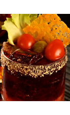 The Cheeseburger drink combines the flavors of America's favorite sandwich into a cool glass. Made from Flor de Cana rum, Roma tomatoes, lettuce, beef stock, mustard powder, cheddar cheese and pickle, and served over ice in a rocks glass.