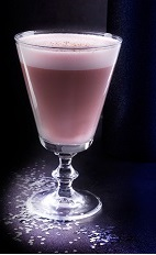 The Christmas Flip is a full bodied Christmas cocktail made in the traditional fashion. A pink colored cocktail made from cherry liqueur, almond milk, pimento dram and whole egg, and served in a chilled wine glass.