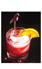 The Cranky Cola drink recipe is a red colored cocktail made from Boca Loca cachaca, Disaronno, cranberry juice and cola, and served over ice in a rocks glass.