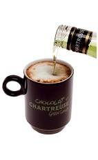 The Green Chaud is a warm brown drink made from Green Chartreuse and hot chocolate, and served in a warm coffee mug.