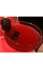 The Lady Lux is a luxurious red colored cocktail recipe made from Flor de Cana white rum, Luxardo maraschino liqueur, sparkling wine, pomegranate juice, raspberries and blackberries, and served in a chilled cocktail glass.