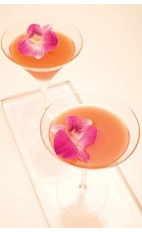The Leblon Orchid cocktail recipe is a peach colored drink made from Leblon cachaca, Grand Marnier orange liqueur, Campari, tangerine juice and apple juice, and served shaken in a chilled cocktail glass garnished with edible orchid petals.