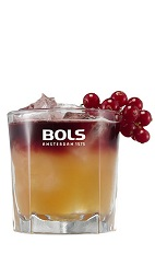 The New York Sour is an orange and red drink made from cognac, orange liqueur, lemon juice, orgeat almond syrup and red wine, and served over ice in a rocks glass.