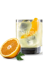 The Orange Sierra Margarita is a refreshing and light orange colored margarita made from Sierra tequila, lime juice and agave nectar, and served over ice in a rocks glass.