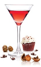 The Red Velvet Cupcake Martini is a smooth red dessert drink made from Frangelico hazelnut liqueur, SKYY vodka, white creme de cacao and maraschino cherry juice, and served in a chilled cocktail glass.