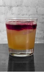 The Sao Paulo Sour is an orange and purple colored drink recipe made from Cedilla acai liqueur, bourbon, egg white, lemon juice and simple syrup, and served over ice in a rocks glass.