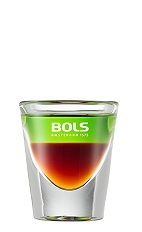 The Shit on the Grass is a layered brown and green shot perfect for any spring or summer party. Made from coffee liqueur and melon liqueur, and served in a chilled shot glass.