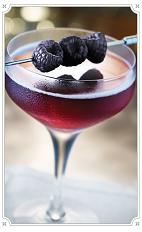 The Sweet Taste of Victory cocktail is made from Chambord raspberry liqueur, bourbon, vanilla syrup and bitters, and served in a chilled cocktail glass.