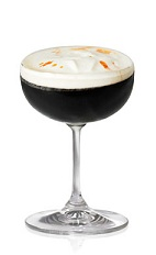 The Domino is a black cocktail made from Patron tequila, Patron XO Cafe liqueur, heavy cream and orange bitters, and served in a chilled cocktail glass or champagne coupe.