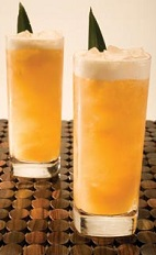 The Tropic Cana Caipirinha is a tropical orange colored drink recipe made from Leblon cachaca, Disaronno amaretto, pineapple juice, guava juice, lime juice and cinnamon, and served over ice in a highball glass.