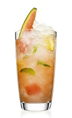 The Tropical Swizzle is a peach colored drink made from Malibu coconut rum, lemon, mint, watermelon and club soda, and served over ice in a highball glass.