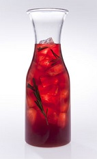 The Winter Caipi Carafe is a red colored drink made from Leblon cachaca, rosemary, pomegranate juice, simple syrup and sparkling wine, and served from a carafe or pitcher. Recipe serves 4-8.