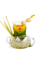The Xellent Thai is a tropical drink recipe made from Xellent vodka, orange juice, lemon juice, chili syrup, lemongrass and lychee fruit, and served over ice in a rocks glass.