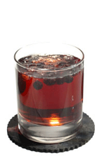The Cassius drink recipe is made from Chymos crème de cassis, tonic water and black or red currant berries, and served over ice in a rocks glass.
