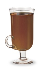 The Fuzzy Nut is a brown Christmas drink made from peach schnapps, amaretto and hot chocolate, and served in an Irish coffee glass.