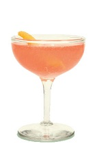 The Nomayo is a peach colored cocktail made from gin, St-Germain elderflower liqueur, Aperol, lemon juice and champagne, and served in a chilled cocktail glass.