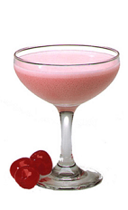 The Pink Cassis is a pink colored cocktail made from Chymos crème de cassis, white crème de cacao, milk and grenadine, and served blended with ice in a chilled cocktail glass garnished with a maraschino cherry.