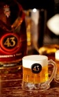 The 43 Mini Beer drink recipe is perfect for a football game or tailgate party. Made from Licor 43 and heavy cream, and served shot glasses.