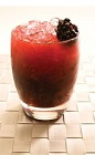 The Blackberry Caipirinha is a dark red colored drink recipe made with Leblon cachaca, blackberries, sugar and lime juice, and served muddled in a rocks glass full of crushed ice.