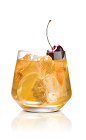 The Burnt Karamel drink is made from Stoli Salted Karamel vodka and brown sugar, topped with orange slices and bourbon-soaked cherries, and served in an old-fashioned glass.