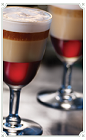 The Cafe Royal is made by layering Chambord liqueur, Irish cream, hazelnut liqueur and orange liqueur in a chilled shot glass.