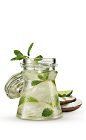 The Coconut Mojito is a tropical variation of the classic Mojito drink recipe. Made from Cruzan coconut rum, white rum, mint, lime, sugar and coconut water, and served over ice in a highball glass.