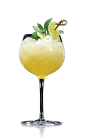 The Daisy de Santiago cocktail is made from Don Q rum, yellow Chartreuse, lime juice, simple syrup, club soda, mint and lime, and served over ice in a wine glass.