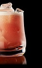 The Jam Sour drink recipe is made from Monkey Shoulder scotch, simple syrup, raspberry jam, lemon juice, club soda and orange bitters, and served over ice in a rocks glass.