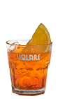 The Spritz drink recipe is an easy to make orange colored cocktail perfect for the light drinkers. Made from Volare Sprizzer aperitif liqueur, prosecco wine and club soda, and served over ice in a rocks glass garnished with an orange slice.