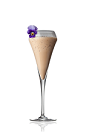 The Sunset Peak is a cream colored drink made from Amarula cream liqueur, crushed ice, violet syrup and whiskey, and served in a chilled champagne flute.