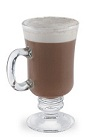 The Vanilla Cinco is a brown drink made from vanilla liqueur and cappuccino, and served in a warm Irish coffee glass.