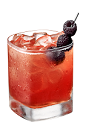 The Velvet Dream drink is made from Chambord flavored vodka, vanilla liqueur, grapefruit juice, cinnamon syrup, pomegranate juice and raspberries, and served over ice in an old-fashioned glass.